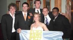 (l-r) Armin Ridinger (Germany), Jerome Leis (the groom), Erin Stewart (the bride), Jonas Binding (Germany), Christoph Loenarz (England), Nish Jayaranjan (Canada) and the Weizmann Institute flag